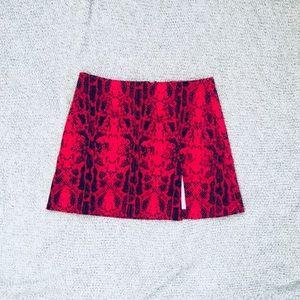 Red snakeskin print mini skirt slit thigh